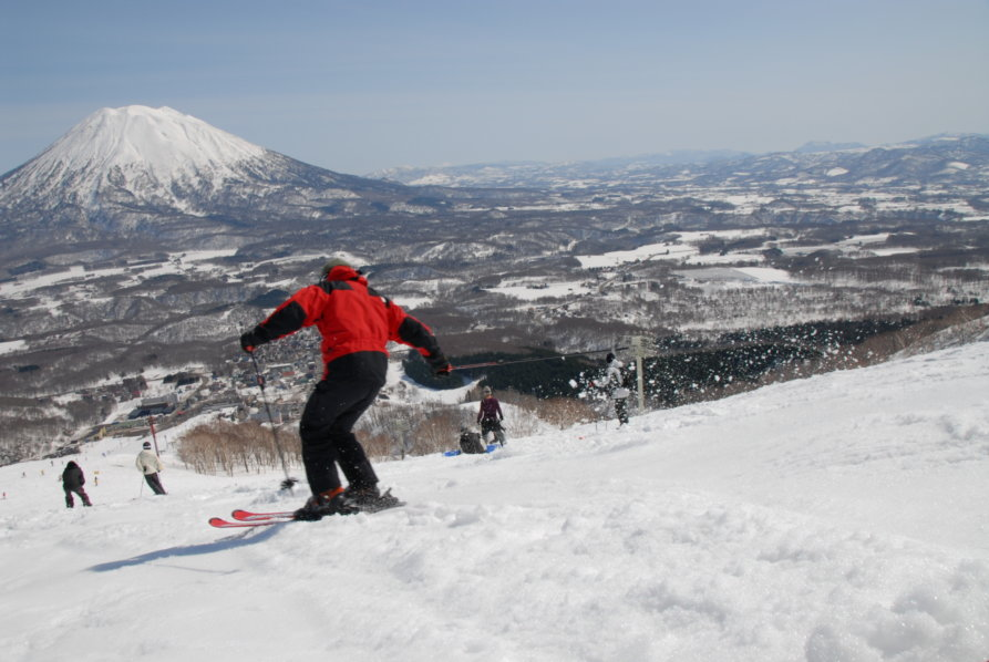 Skier With Hirafu In The Distance