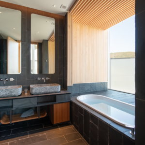 His and her sinks next to the comfortable shower and bath.